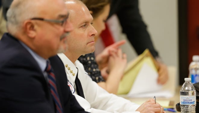 Hortonville Police Chief Michael Sullivan, center, appears before the village's Police Commission in December.