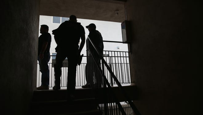 """FILE - Immigration and Customs Enforcement (ICE), agents arrive to detain an immigrant in Los Angeles, California. Recently, there have been reports of immigration """"raids"""" across Southern California, including Ventura County, Thursday, Feb. 9, prompting a protest in downtown Los Angeles and a statement from a state lawmaker for federal officials to state the nature of their actions."""