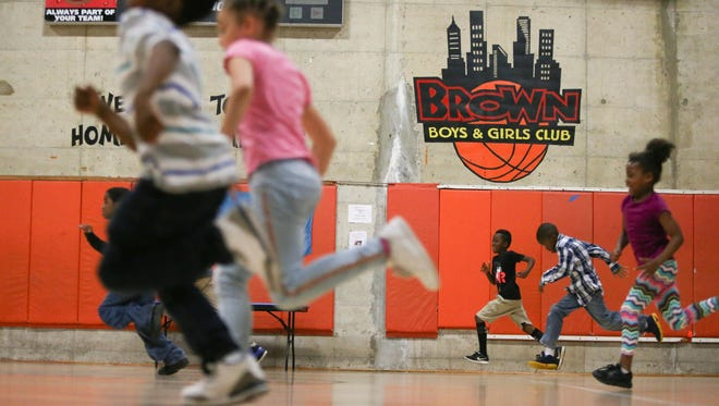 Children play on a new basketball court at the H. Fletcher Brown Boys & Girls Club in Wilmington Tuesday. The new flooring was part of a $95,000 upgrade made possible by the City of Wilmington.