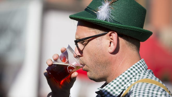 Aaron Delashmutt, of Ahwatukee, drinks an beer during SanTan Brewing's 10th annual Oktoberfest on September 30, 2017 in Chandler.