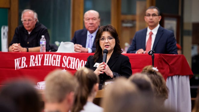 """Cissy Reynolds-Perez, principal of Ray High School, introduces state Rep. Todd Hunter (from left), state Sen. Juan """"Chuy"""" Hinojosa and state Rep. Abel Herrero during a forum at Ray High School between students and legislators about school safety Tuesday, March 6, 2018."""