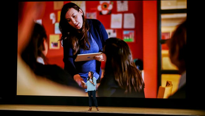 Teacher Kasia Derza of the Mariano Azuela Elementary School in Chicago speaks at Apple's education-focused event at Lane Technical College Preparatory High School. Photo by Rodney White, Gannett