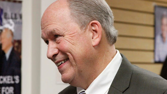Bill Walker, an independent candidate for Alaska governor, is shown talking to a supporter after a Nov. 12, 2014, news conference in Anchorage, Alaska.