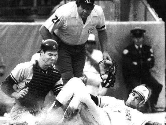New York Yankees catcher Joel Skinner blocks home plate and puts out Damaso Garcia of the Toronto Blue Jays as umpire Ken Kaiser gets a good look in American League baseball action in Toronto. (AP photo, 9/11/1986)