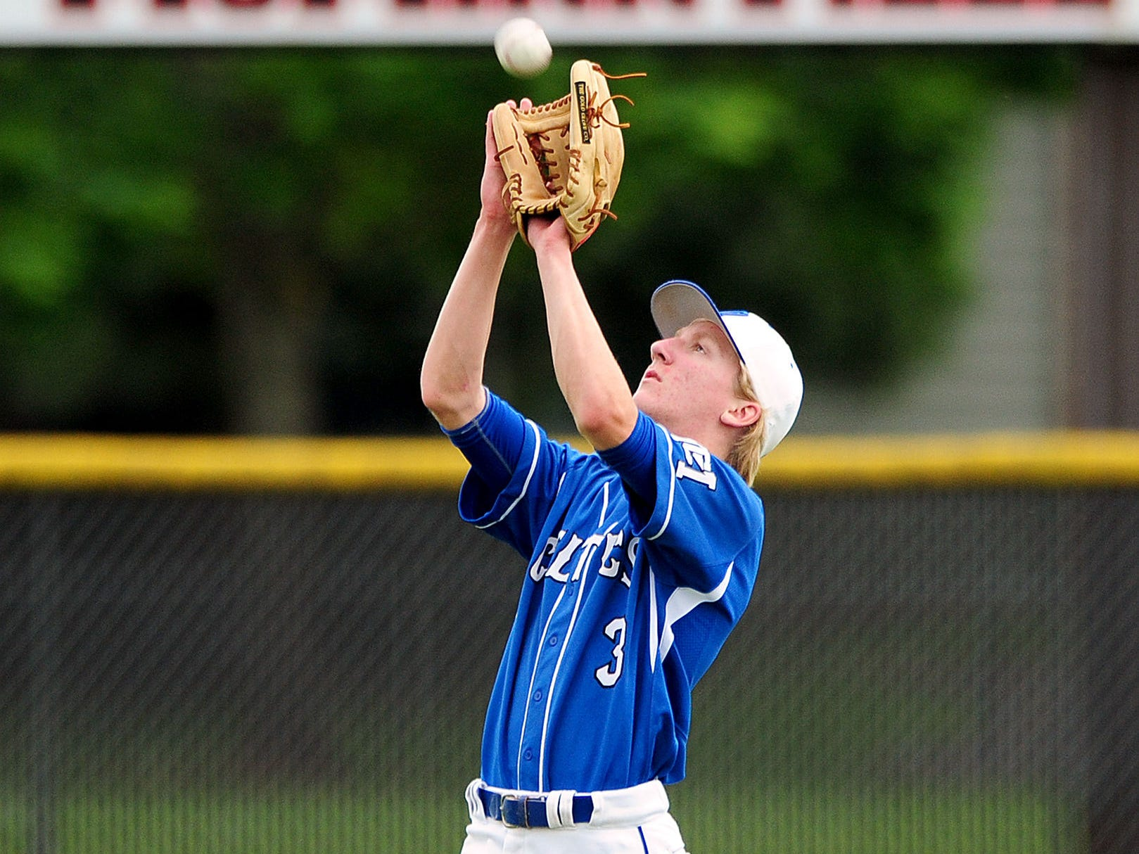 McNary center fielder Jacob Vasas catches a fly ball against McMinnville, on Wednesday, May 13, 2015, in McMinnville.
