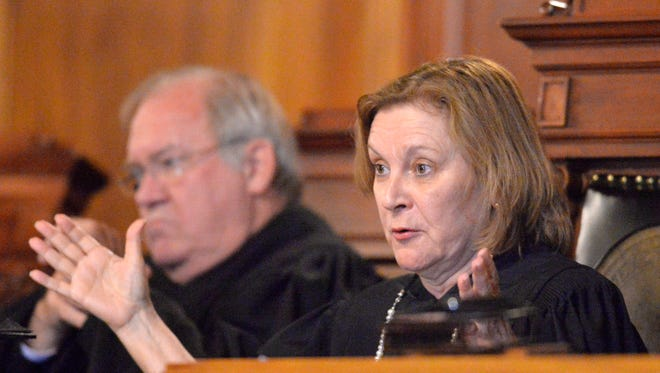Kentucky Supreme Court Justice Lisabeth T. Hughes asks a question during oral arguments in a case that seeks clarification on what a judge is allowed to do when a jury lacks diversity Thursday in the Kentucky Supreme Court Courtroom in Frankfort, Ky. (Timothy D. Easley/Special to the C-J)
