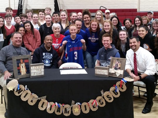 Family, friends and coaches join West Valley High School's JoeLyn Stirton, center, last month after she signed her National Letter of Intent to play basketball at William Jessup University.