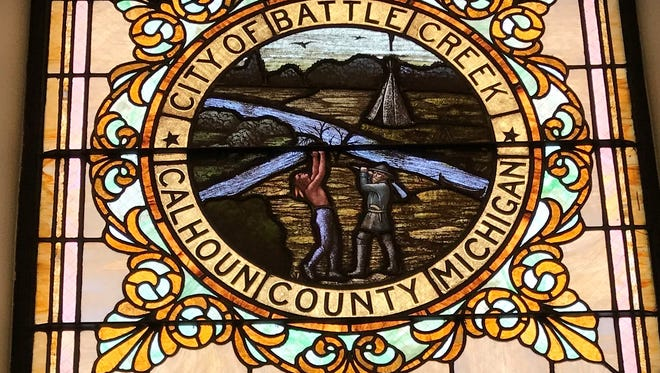 The city plans to remove the stained glass window that depicts a version of the city seal.