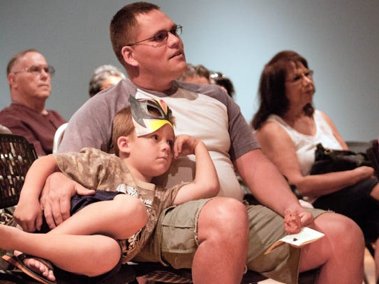 Zack Mickendrow, 6, sits with his father Christopher