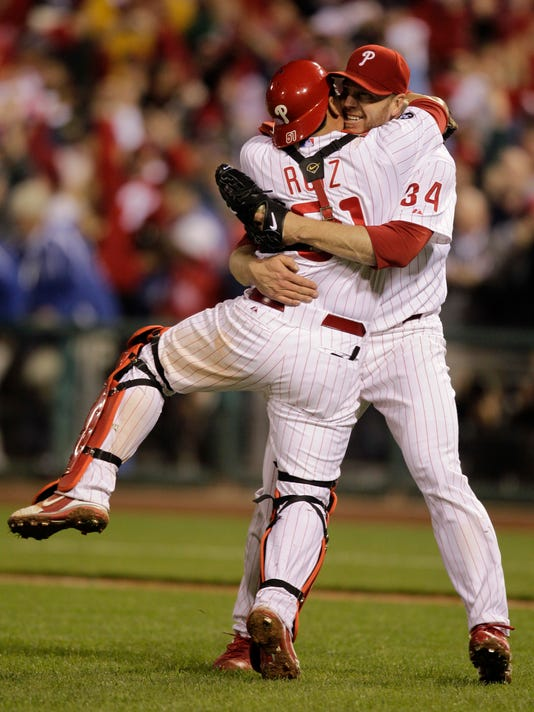 FILE - In this Oct. 6, 2010, file photo, Philadelphia Phillies starting pitcher Roy Halladay celebrates with catcher Carlos Ruiz (51) after throwing a no-hitter to defeat the Cincinnati Reds 4-0 during Game 1 of baseball's National League Division Series, in Philadelphia. Authorities have confirmed that former Major League Baseball pitcher Roy Halladay died in a small plane crash in the Gulf of Mexico off the coast of Florida, Tuesday, Nov. 7, 2017. (AP Photo/Rob Carr, File)
