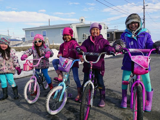 Girls living in Shishmaref, Alaska, pose for a photo