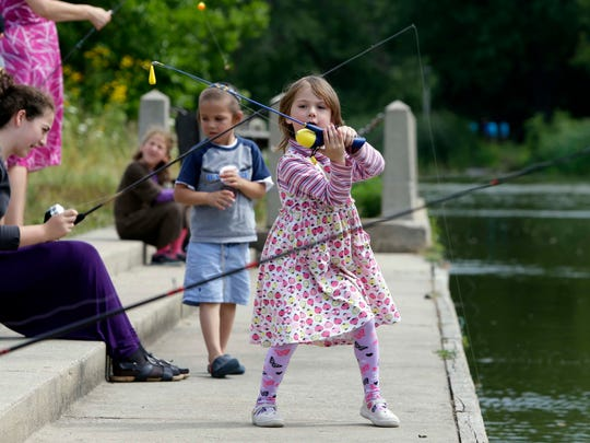 Liba Seskutov, 5, joins other children at a fishing class at the Urban Ecology Center at Washington Park on Aug. 13, 2015.