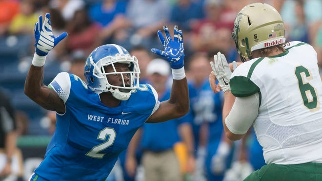 University of West Florida linebacker Andre Duncombe pressures Missouri S&T quarterback Tyler Swart last season in Pensacola. Duncombe was named to the All-Gulf South Conference preseason team on Thursday.