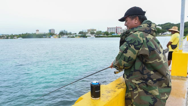 Er Pascual, 58, fishes during a day off from work in Hagåtña, July 16, 2018.