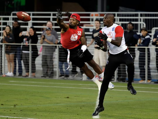 Omar Bolden, left, breaks up a pass intended for Chad
