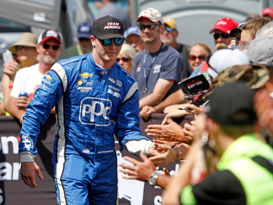 Josef Newgarden is seen during driver introductions for the IndyCar Honda Indy 200 auto race Sunday, July 30, 2017, at Mid-Ohio Sports Car Course in Lexington, Ohio. (AP Photo/Tom E. Puskar)