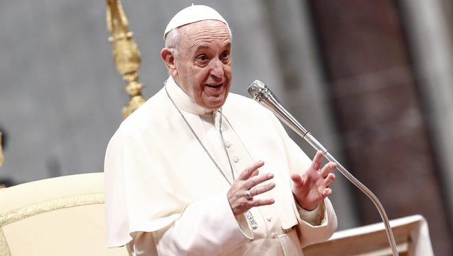 Pope Francis speaks during a general audience in St. Peter's Basilica in Vatican City on March 7, 2018.