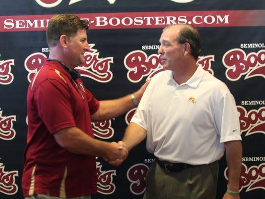 FSU alumni Hunter Leak shakes hands with coach Jimbo