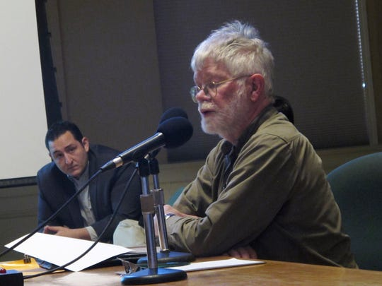 Burlington South End resident Larry Ribbecke, right, airs criticism Tuesday night of a proposal to redevelop the Pine Street Deli. Also at the Development Review Board hearing, at left, is Mike Alvanos, whose family has owned and operated the deli for about a decade.