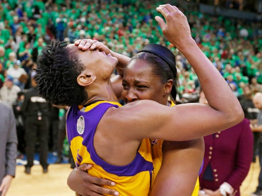 FILE - In this Oct. 20, 2016, file photo, Los Angeles Sparks' Alana Beard, left, and Chelsea Gray celebrate after the Sparks beat the Minnesota Lynx 77-76 to win the WNBA basketball finals in Minneapolis. Last year's WNBA Finals were so good they're doing it all over again. The defending champion Los Angeles Sparks play the Minnesota Lynx, who are in the finals for the sixth time in the last seven years. Game 1 is on Sunday in Minneapolis. (AP Photo/Jim Mone, File)