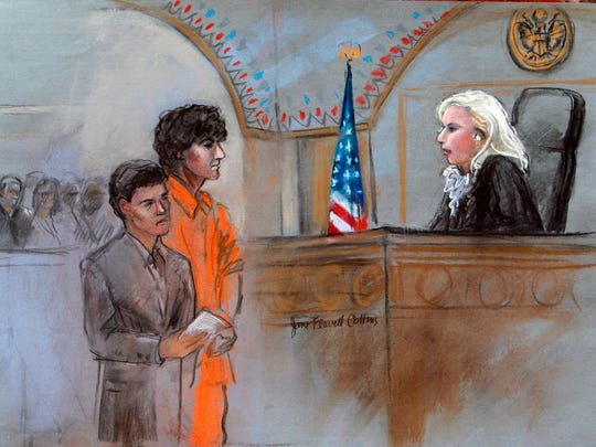 This courtroom sketch depicts Boston Marathon bombing suspect Dzhokhar Tsarnaev standing with his lawyer Miriam Conrad, left, before Magistrate Judge Marianne Bowler, right, during his arraignment in federal court Wednesday, July 10, 2013 in Boston.