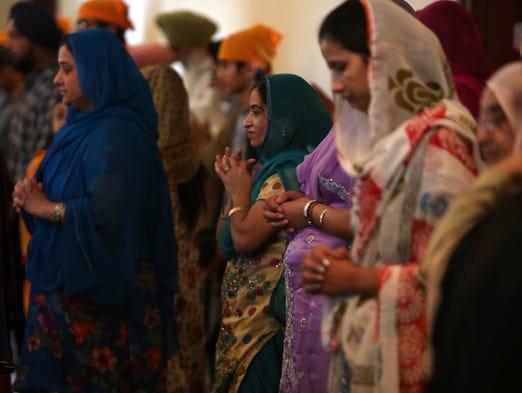 Women worship inside of the Guru Nanak Society Gurdwara