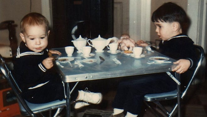 The author (right) and one of his brothers having a tea party while wearing sailor suits in 1969.
