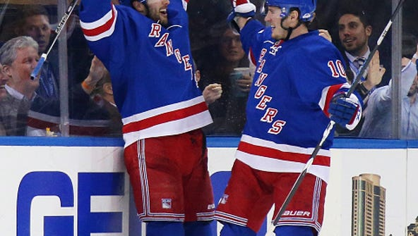 Derick Brasard (left) and J.T. Miller celebrate Brassard's