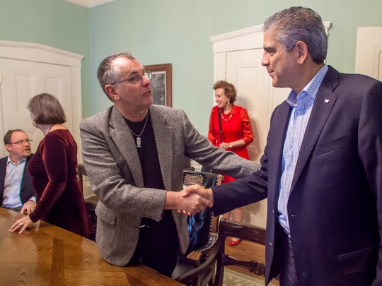 "Left, Cliff Bennett greets Palestinian Ambassador Maen Rashid Areikat at the Pomerleau building in Burlington this fall. ""You can be pro-Israel and pro-Palestinian at the same time,"" the ambassador said. ""I think what you are doing is excellent."""