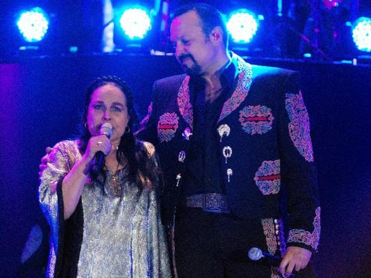 Pepe Aguilar sings at a special concert with his mother Flor Silvestre in 2014.