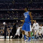 Kentucky Wildcats forward Alex Poythress (22) reacts after losing to the Connecticut Huskies in the championship game of the Final Four in the 2014 NCAA Mens Division I Championship tournament at AT&T Stadium.