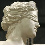 The face profile with the blind justice eye wrapping is seen on the silicon bronze statue made to replicate the Lady Justice statue.