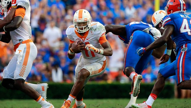 Tennessee quarterback Joshua Dobbs (11) runs with the ball against Florida on Sept. 26, 2015.