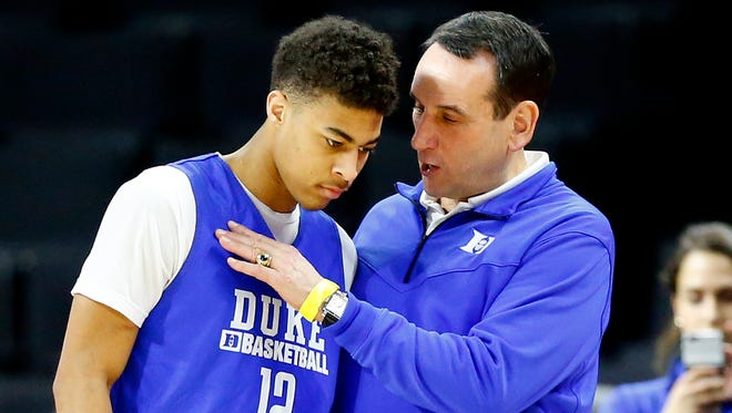 Mar 16, 2016; Providence , RI, USA; Duke head coach Mike Krzyzewski talks with Derryck Thornton (12) during practice a day before the first round of the NCAA men's college basketball tournament at Dunkin Donuts Center. Mandatory Credit: Winslow Townson-USA TODAY Sports