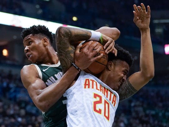 Milwaukee Bucks' Giannis Antetokounmpo ties up Atlanta Hawks' John Collins during the first half of an NBA basketball game Saturday, March 17, 2018, in Milwaukee. (AP Photo/Morry Gash)