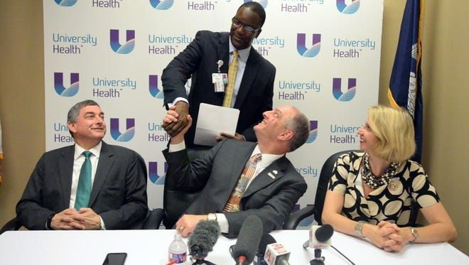 Rod Williams, President of University Health shakes hands with Gov. John Bel Edwards after announcing that University Health achieved their three year creditation and that they also achieved the necessary accrediting to become a primary stroke center. Looking on are Lt. Gov. Jay Dardenne and Dr. Rebekah Gee.