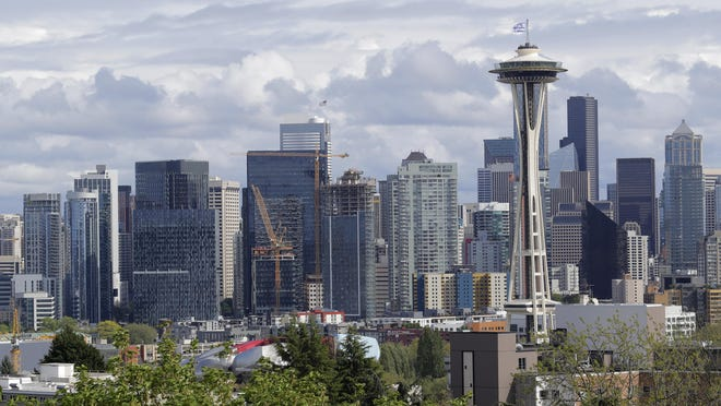 The Space Needle and the Seattle skyline are shown against a cloudy sky, Thursday, April 30, 2020, as seen from Kerry Park.