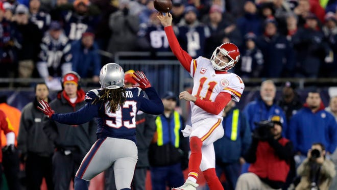 Kansas City Chiefs quarterback Alex Smith (11) passes over New England Patriots defensive lineman Jabaal Sheard (93) in the second half of an NFL divisional playoff football game, Saturday, Jan. 16, 2016, in Foxborough, Mass. (AP Photo/Charles Krupa)