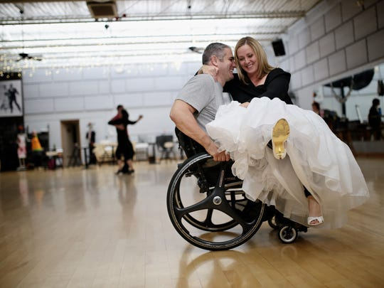 John Palmer, 37, of Lansing, and Corey Longley, 36, of Lansing, practice on Friday, Oct. 30, 2015, at Fred Astaire Dance Studio in Bloomfield Hills. Palmer, who is taking wheelchair ballroom dancing lessons with his fianceeŽ, has been paralyzed in a wheelchair for 20 years. The couple will do their first dance at their wedding on Nov. 21.