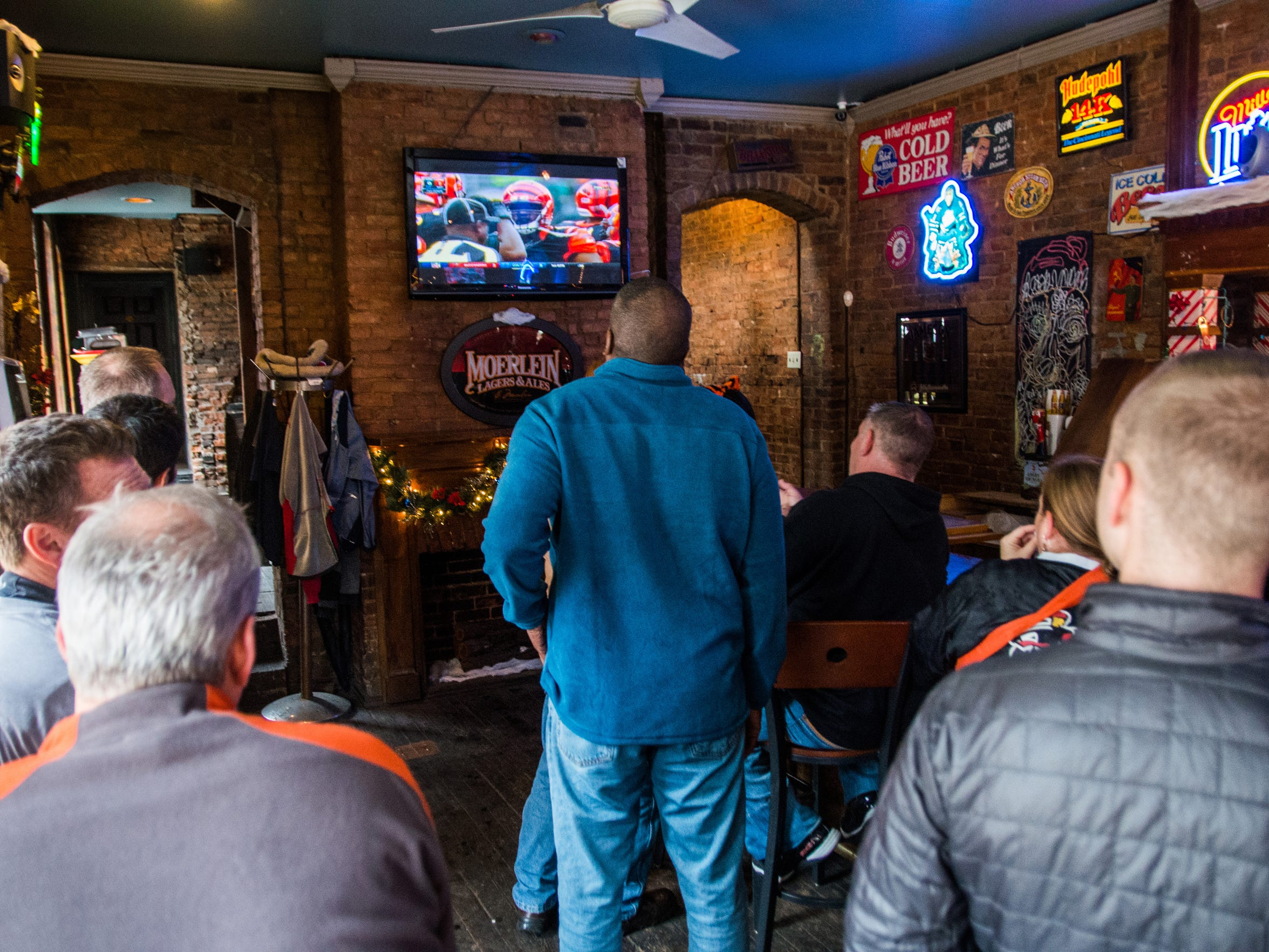 Community members gather inside Milton's Bar Nov. 29 for Bengals' game days. The bar has hosted a potluck for the fans for several years.