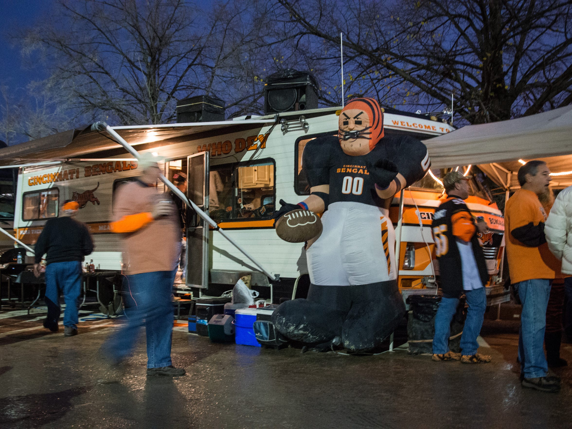 """Bengals fans tailgate in the Hilltop lot along Mehring Way Nov. 16. Fans deck out their tailgating spot in Who Dey and Bengals gear. """"It puts a smile on your face and let's you know you are doing good on the field and fans are taking notice,"""" Bengals defensive lineman Carlos Dunlap said of the Who Dey difference."""