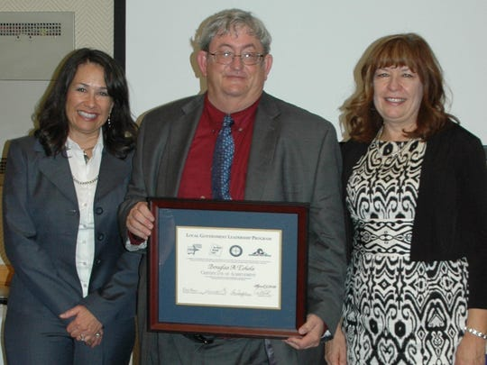 Doug Echols, attorney for San Juan County, center, recently graduated from the Local Government Leadership Program.