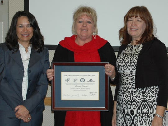 Donica Sharpe, the GIS and planning and zoning director for the city of Bloomfield, center, recently graduated from the Local Government Leadership Program.