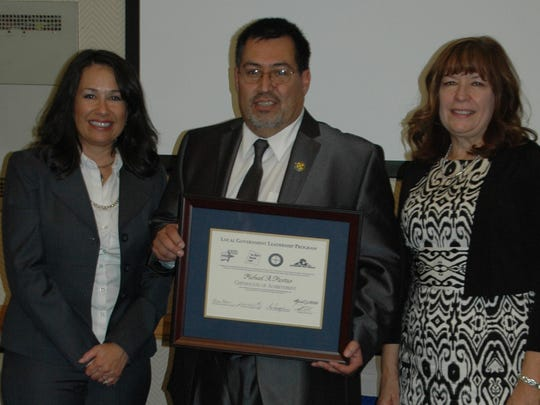 Mike Mestas, coordinator of San Juan County's Office of Emergency Management, center, recently graduated from the Local Government Leadership Program.