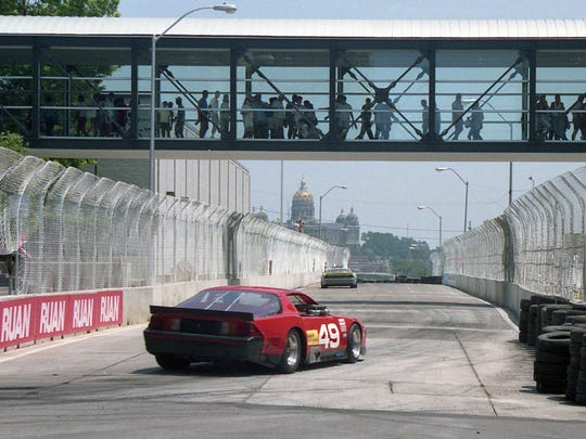 Race cars head east through downtown Des Moines during the 1989 Ruan Greater Des Moines Grand Prix. The city hosted the races from 1989 to 1994.