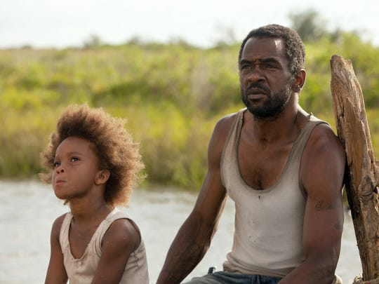 "This film image released by Fox Searchlight Pictures shows Quvenzhane Wallis portraying Hushpuppy, left, and Dwight Henry as Wink in a scene from, ""Beasts of the Southern Wild."" (AP Photo/Fox Searchlight Pictures, Jess Pinkham)"