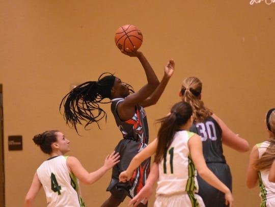 The Raiders' Lapresha Stanley soars above the Hawks