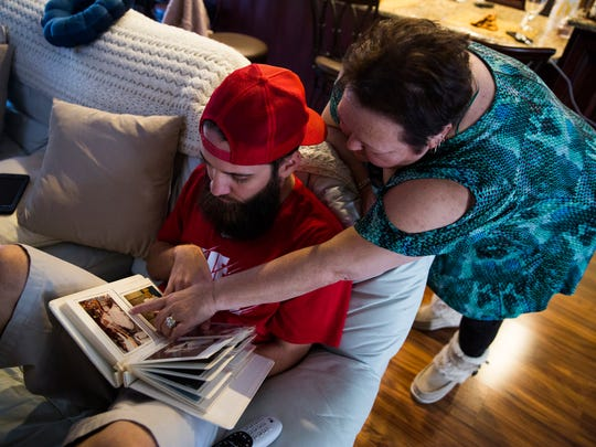 Kathy Good points out people in her wedding album as Brice Foutch flips through the pages  in Granite Falls, North Carolina, on Friday, Dec. 2, 2016.