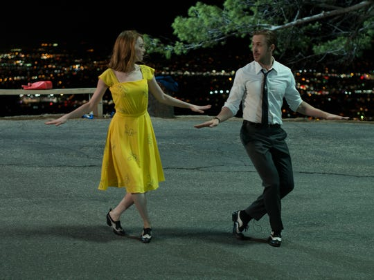 Mia (Emma Stone) and Sebastian (Ryan Gosling)  perform their 'A Lovely Night' song and dance in 'La La Land,' which won best musical or comedy at the Golden Globes.