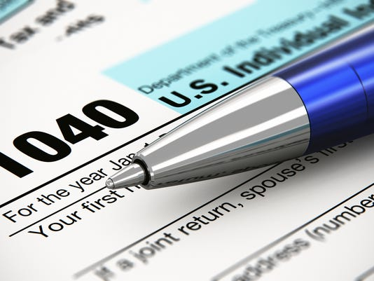 The 1040 US individual return tax form and ballpoint pen